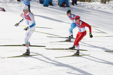 12 13: SOCHI, RUSSIA - FEBRUARY 23, 2014  Richardsson, Cologna and Heikkinen during Men s Cross-country 50km mass start competition at Sochi 2014 XXII Olympic Winter Games Editorial