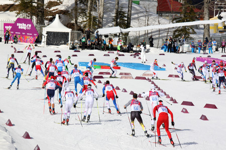 crosscountry: SOCHI, RUSSIA - FEBRUARY 23, 2014  sportsmen during Men s Cross-country 50km mass start competition at Sochi 2014 XXII Olympic Winter Games Editorial