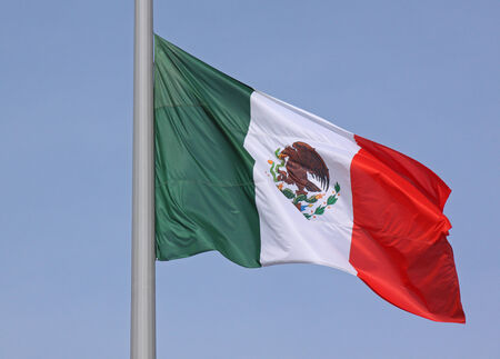 flyaway: flag of Mexico over blue sky