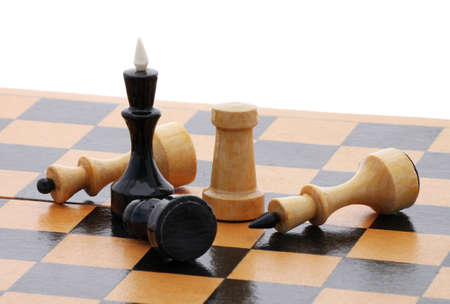 detail of wooden chessboard with several chessmen over white Stock Photo
