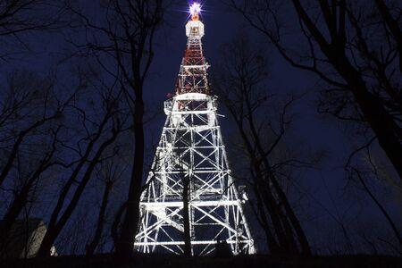 illuminated broadcast tower in Lviv at night