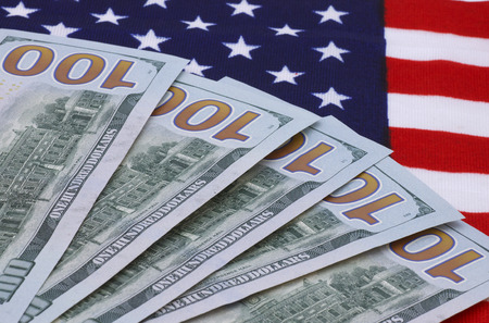 one hundred dollars: one hundred dollars banknotes on USA flag Stock Photo