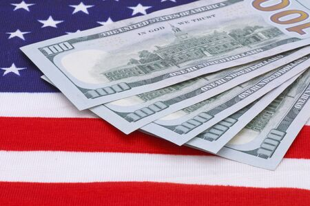 fan shaped: one hundred dollars banknotes on USA flag Stock Photo