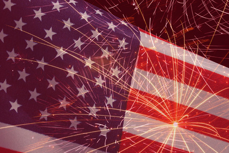 holiday background with fireworks over United States flag