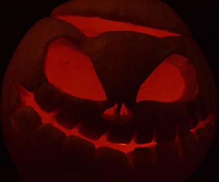 alight: Halloween pumpkin alight in darkness