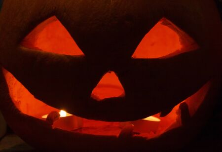 darkness: Halloween pumpkin alight in darkness