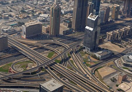 flyover: DUBAI, UAE - MAY 20, 2016: view on road flyover in Dubai from At The Top, Burj Khalifa tower