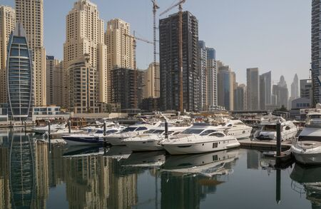 speedboats: DUBAI, UAE - MAY 11, 2016: speedboats in yacht club of distict Marina in Dubai