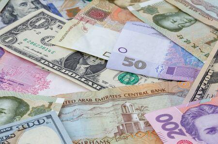 several: heap of several currencies banknotes