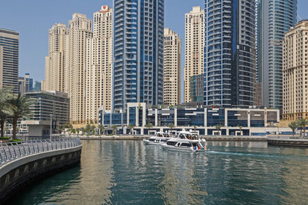 speedboats: DUBAI, UAE - MAY 12, 2016: speedboats in gulf of Dubai Marina district Editorial