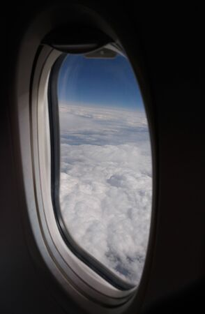 window view: view on clouds through aircraft window