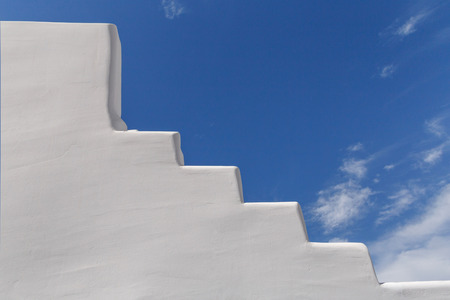whitewashed: whitewashed staircase on Santorini over blue sky