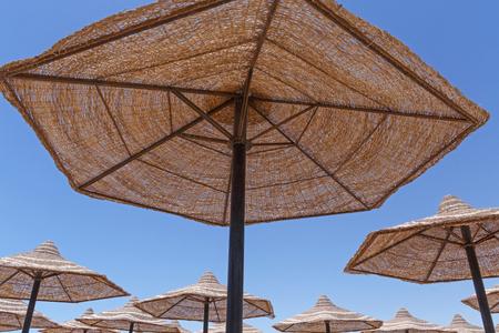 sunshades: sunshade beach umbrellas against blue sky