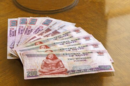 fan-shaped Egyptian pounds banknotes on table