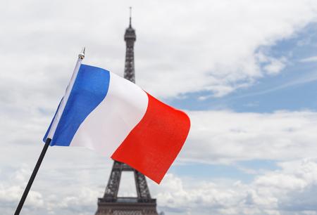 flag of France against Eiffel tower