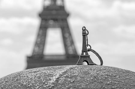 Eiffel tower keychain against real Eiffel tower Stock Photo