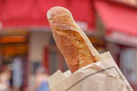 French baguette against street in Paris Stock Photo