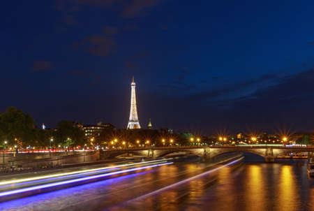 PARIS, FRANCE - June 27, 2017: view on Pont des Invalides and Eiffel tower at night