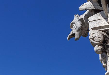 gargoyle on The Basilica of the Sacred Heart of Paris against blue sky