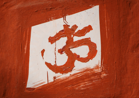 Om sign painted on wall of Hindu  temple in India