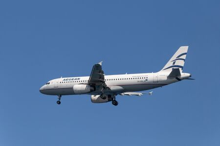 SANTORINI, GREECE - OCTOBER 01, 2016 - landing of Aegean Airlines aircraft Airbus A320 on Santorini