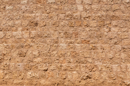 light brown wall made of coquina stones