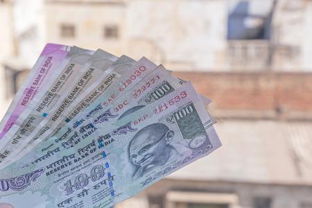 Indian rupee banknotes against old buildings 版權商用圖片 - 119182575