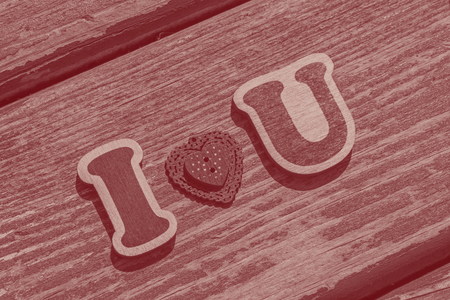 I love u message made of wooden letters and valentine button
