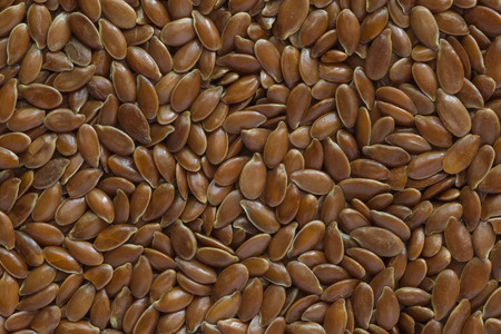 close up of brown flaxseeds background