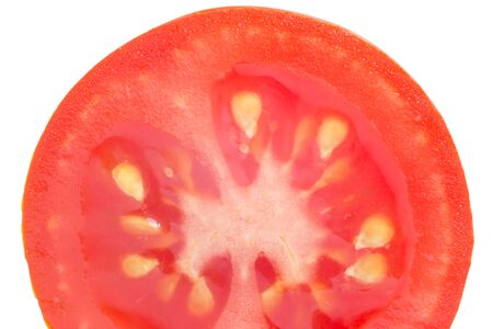 close up of half of red tomato isolated on white