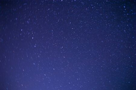 short trails of stars rotating around Polar star 写真素材