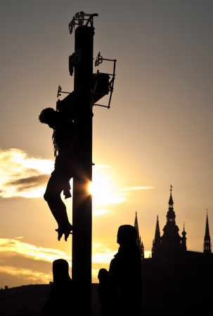 praha: Jesus crucified on the cross at sunset in Praha