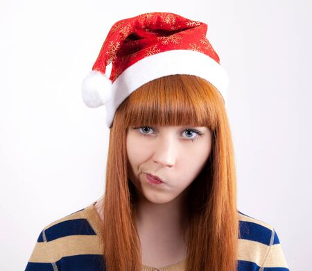 whim: cute big eyes whimsical girl in a New Years cap Stock Photo