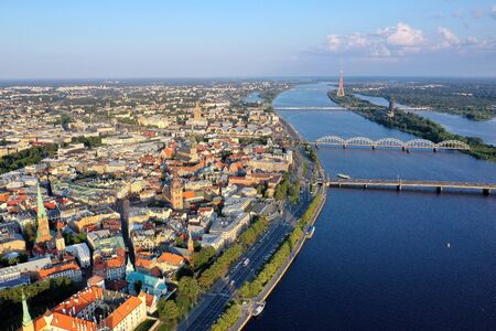 Beautiful view of the old city of Riga from a height, shot on a drone. In the middle Daugava river bridges and TV tower. Panarama with old building.