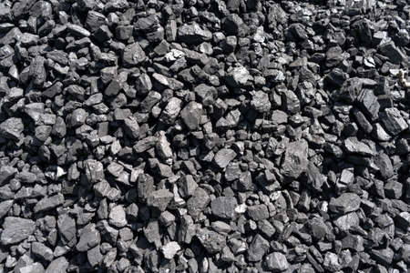 Natural coal deposits. Texture and background. Fine fraction. Top view of fuel for industry.