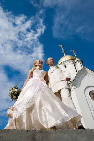 Newlyweds in front of church  photo
