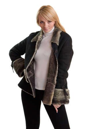 furskin: The young beautiful woman in grey sheepskin coat.