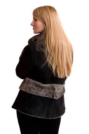 furskin: The young beautiful woman in grey sheepskin coat   Stock Photo