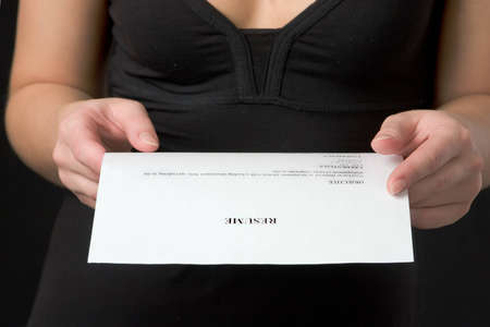 Closeup of hands. The woman holds the resume. Stock Photo - 13852401