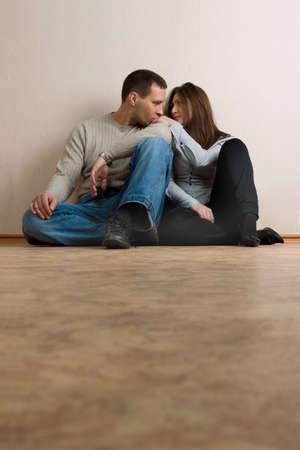heterosexuality: Young couple in empty room. Stock Photo