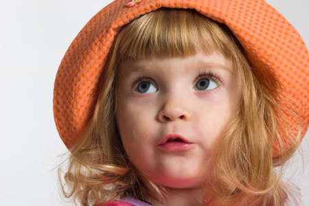 bonnet up: Portrait of little girl in orange hat