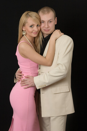 The young girl embrace the guy for a neck, and he embraces her for a waist.