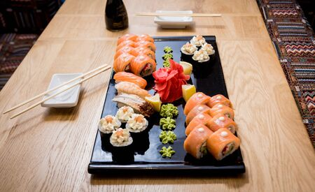 Sushi set. Rolls with salmon, eel and red caviar on a wooden plate. Restaurant. Stock fotó
