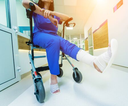 Patient on rollator with hand brakes moving in hospital