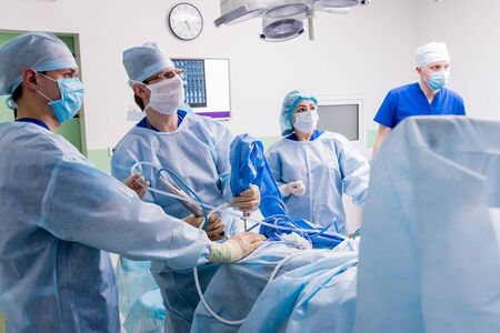 Arthroscope surgery. Orthopedic surgeons in teamwork in the operating room Stock Photo - 140190922