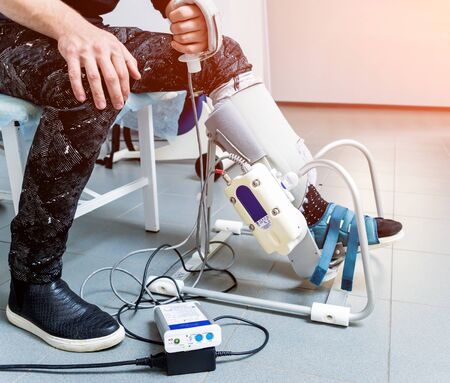 Patient on CPM machines, continuous passive range of motion. Device to provide anatomically correct motion to both the ankle and subtalar joints. Foot's rehabilitation after injured