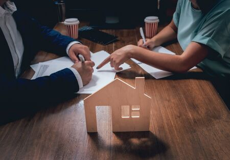 Man sign a home insurance policy on home loans