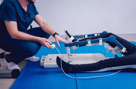 Patient on CPM machines. Continuous passive range of motion. Device to provide anatomically correct motion to both the ankle and subtalar joints. Foot's rehabilitation after injured