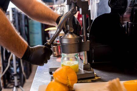 Metal manual juicer. Preparation of freshly squeezed orange juice