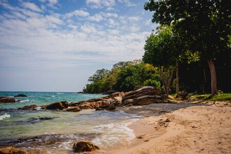 View of beautiful tropical beach with palms. Sand and stones. Caribbean sea. Фото со стока